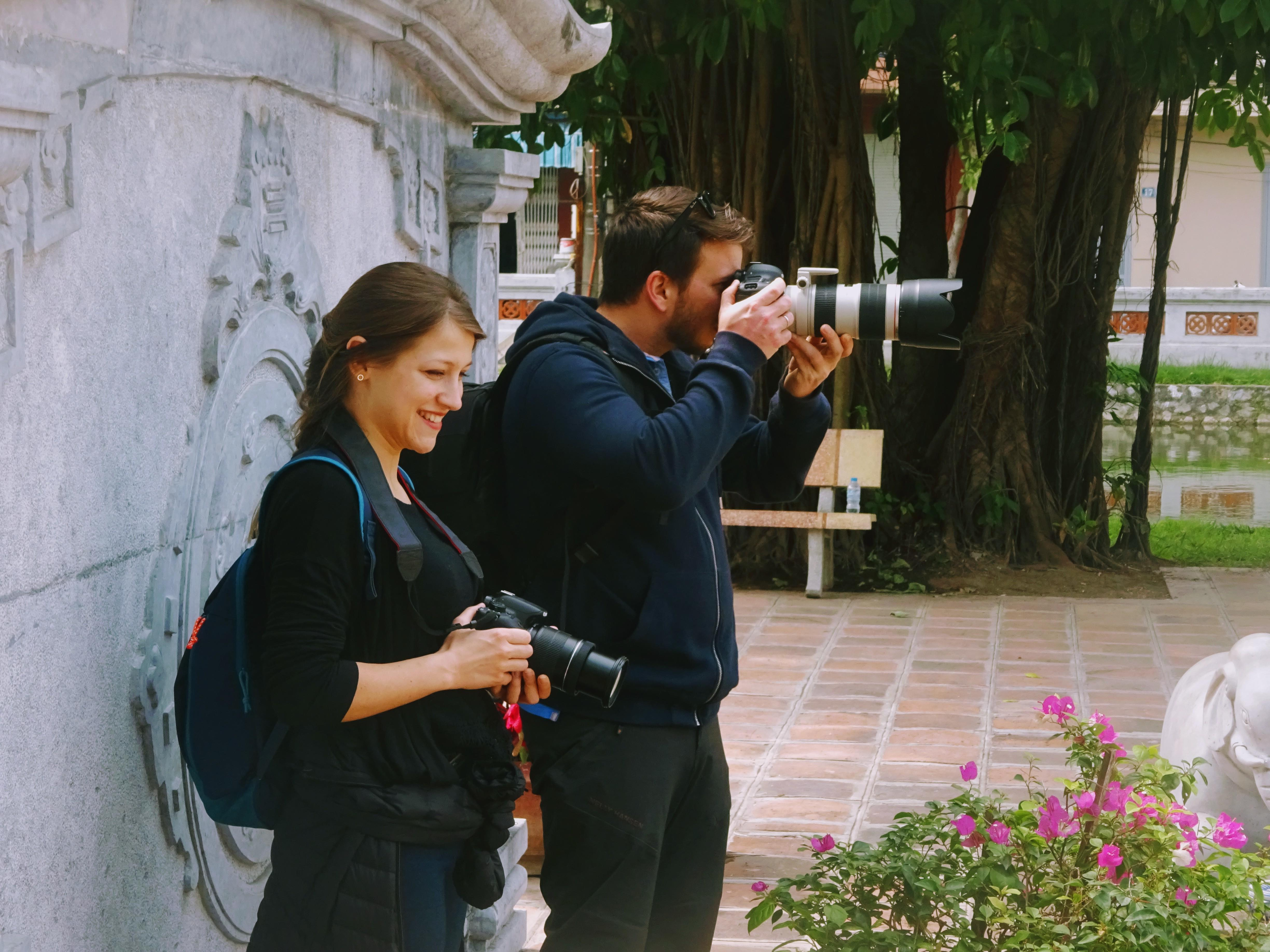 Interns take pictures during a social events in Vietnam